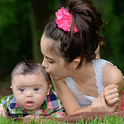 Little girl kissing baby sibling