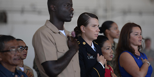 Service members and spouses during naturalization ceremony