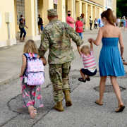 Military family walking in street