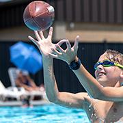 Kid playing football in pool