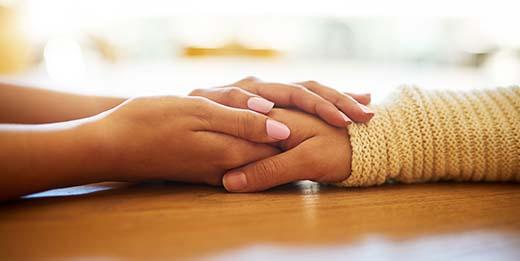 Holding hands in comfort