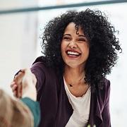 Woman shaking someone's hand